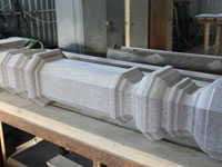 Fabrication of a hewn baluster from gray granite of the Surtas field